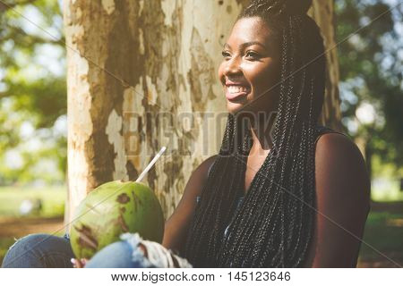 Afro young woman enjoying a hot day in the park