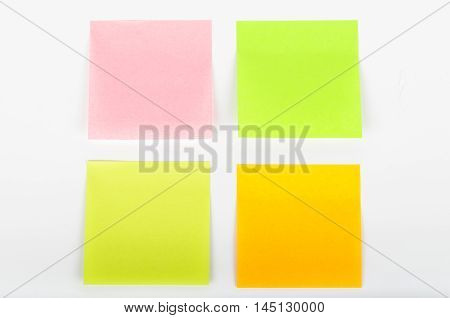Various colors of postit notes on white background