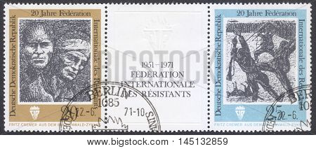 MOSCOW RUSSIA - CIRCA AUGUST 2016: a stamp printed in DDR shows Lithography by Fritz Cremer the series