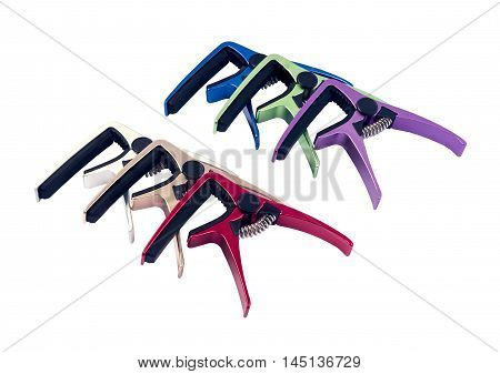 Guitar colorful capo on white background close up