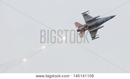 Leeuwarden, The Netherlands - Jun 11, 2016: Dutch F-16 Fighter Jet Firing Off Flares During A Flyby