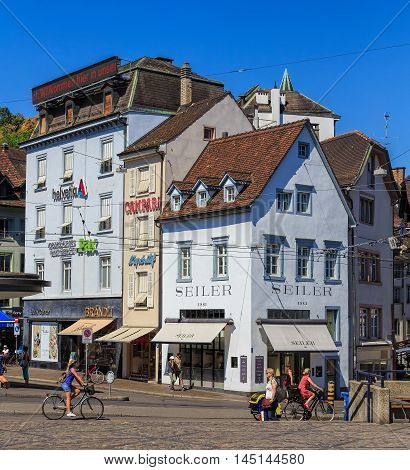 Basel, Switzerland - 27 August, 2016: buildings and people on Barfuesserplatz square. Basel is a city on the Rhine river in northwestern Switzerland, situated where the Swiss German and French borders meet.