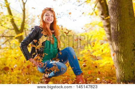 Crazy Girl Throwing Leaves.