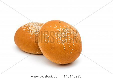 foodstuffs sesame brown buns on white background