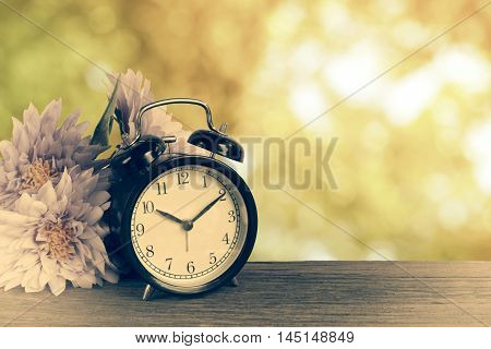 Alarm Clock On Wood With Shinny Bokeh In Background
