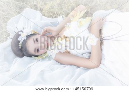 Bride and groom wedding portrait outdoors newlyweds loving couple at field marriage bridal flowers Beautiful young woman in evening dress of soft light at Thailand