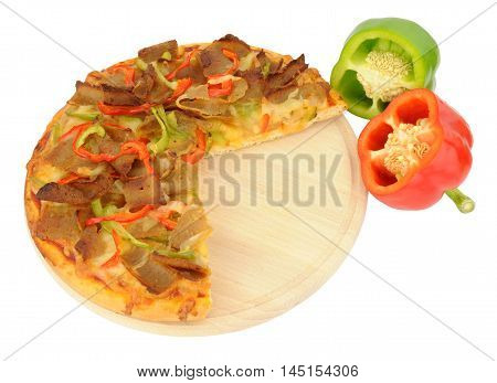 Doner meat and sweet pepper pizza on a wooden cutting board isolated on a white background