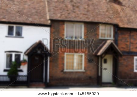 BEACONSFIELD ENGLAND - JUNE 2016: Old terrace houses in the old town Out of focus.