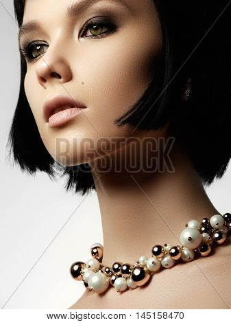 The Beautiful Woman In Expensive Pendant Close-up. Beautiful You