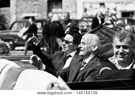 Podol, Ukraine - May 19, 2016: Elegant Man On Sunglasses Ray Ban With Cigarette Sitting On Maybach C