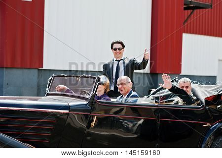 Podol, Ukraine - May 19, 2016: Elegant People On Sunglasses Stay On Maybach Cabriolet, Luxury Classi