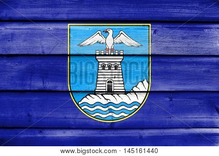 Flag Of Opatija, Croatia, Painted On Old Wood Plank Background