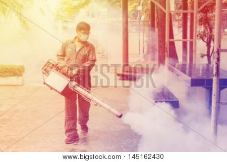 Blurred background fogging to eliminate mosquito for prevent spread dengue fever