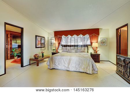 Master Bedroom Interior With Elegant Red Curtains