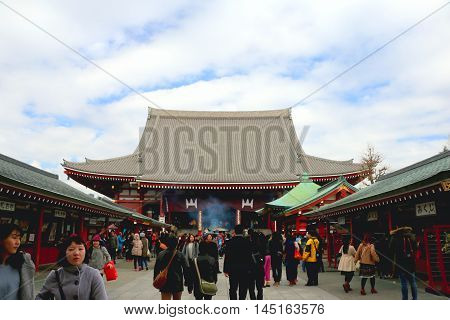Sensoji Temple, Asakusa-Japan-Feb 19 2016 :Thai tourists came to Sensoji Temple ,Japan on 19 Feb 2016 for make merit and respect buddha image in the Sensoji Temple ,Asakusa-Japan .The sensoji temple in japan is top ten of travel location of Thai tourist.