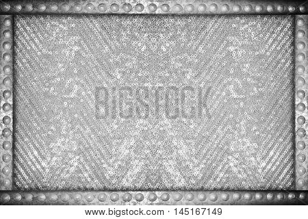 Silver sparkle glittering background with metal rivets frame