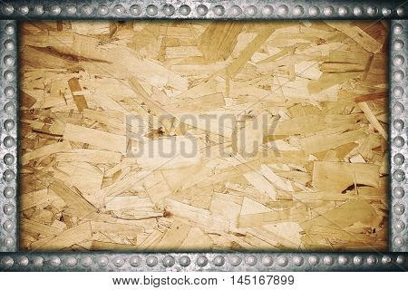 Meat plywood frame with metal pins for background.
