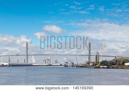 Industry beneath susnpension bridge on the Savannah River