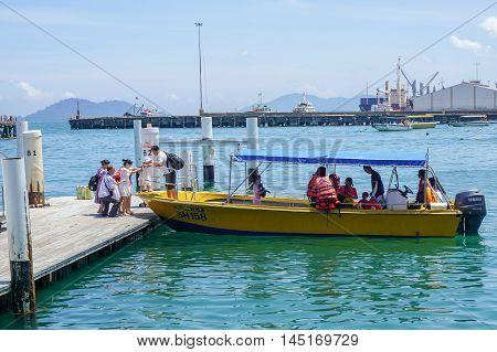 Kota Kinabalu,Sabah-Aug 30,2016:A view of tourist boats at Jetty Jesselton Point,Kota Kinabalu,Sabah.This jetty provided tourists facilities to the islands in Tunku Abdul Rahman Marine Park nearby.