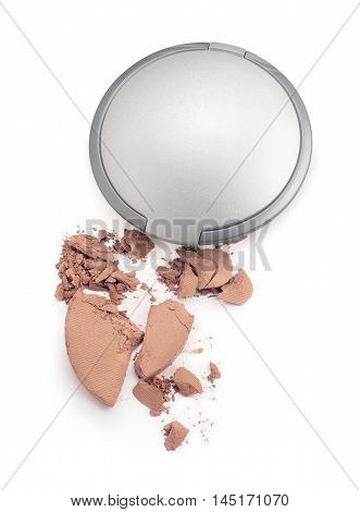 Broken make up powder and container on white background