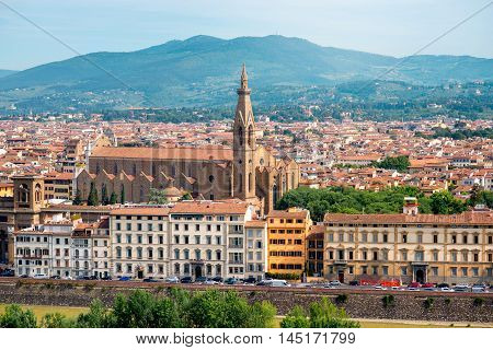 Florence aerial cityscape view from Michelangelo square on the old town with Santa Croce church in Italy