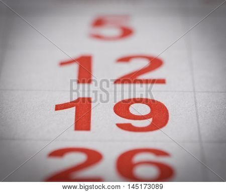 close up red white calendar nineteen number