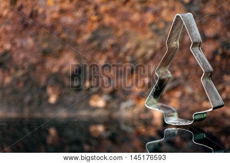 Cookie Cutter In Front Of Rusty Background, Christmas Tree