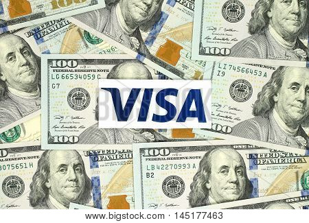 Kiev, Ukraine - June 13, 2016: Visa logo printed on paper and placed on money background. Visa is an American multinational financial services corporation