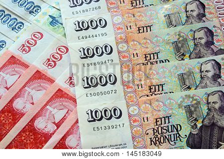 Different Iceland Krona Banknotes arranged as a Background
