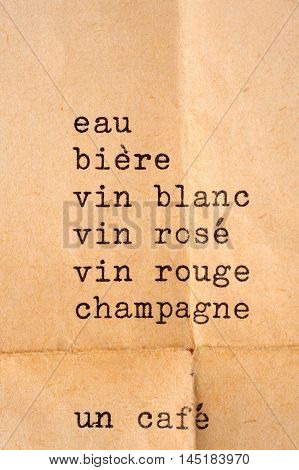 list with drinks in French in typewriter font - translation of the French text: water beer white wine rose wine red wine champagne a coffee