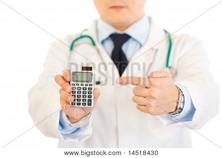 Medical doctor pointing finger on calculator isolated on white. Close-up.
