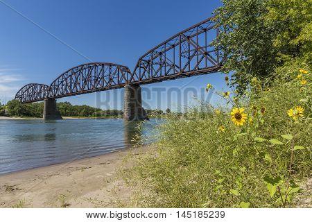 A railroad bridge crossing the Missouri River.