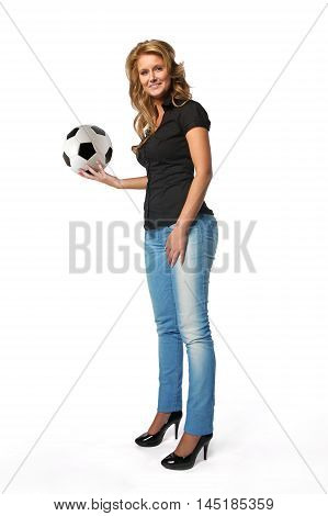 Attractive young woman holding a soccer football. Isolated against a white background.
