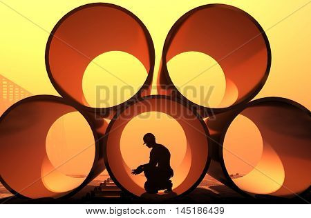 Silhouette of worker in the pipes.,3d render