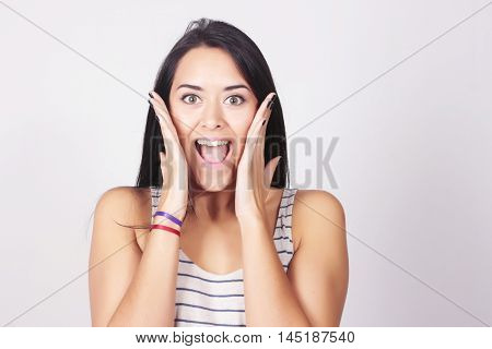 Young Beautiful Woman With Surprised Expression