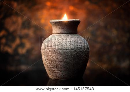 Romantic Candlelight In Front Of Brown Background