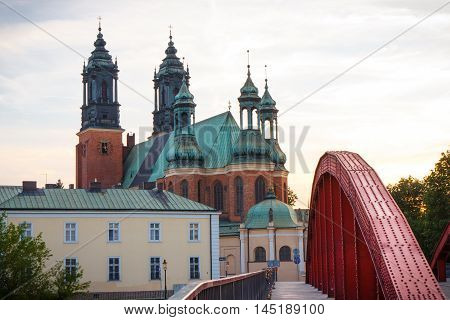 Poznan, Poland - July 1, 2016: View At Sunset On Old Bridge And Cathedral Church In Polish Town Pozn