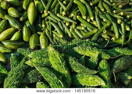 Many green vegetables ladyfingers and karela in Indian market