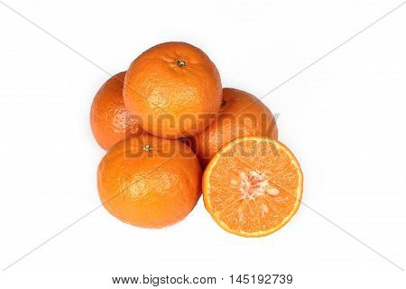 4 Oranges and orange halves on white background.
