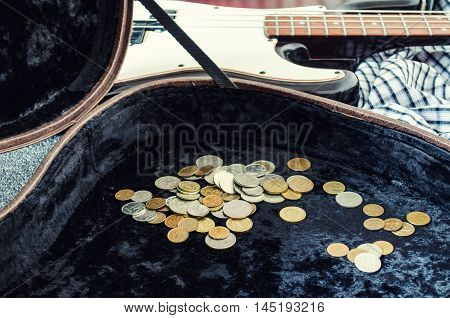 earned a trifle hard case and bass guitar