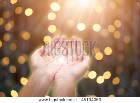 Woman giving or holding hands on celebration bokeh background. Giving concept