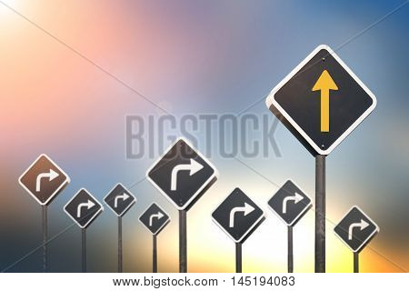Different way concept by go straight yellow arrow traffic sign and many turn right traffic sign