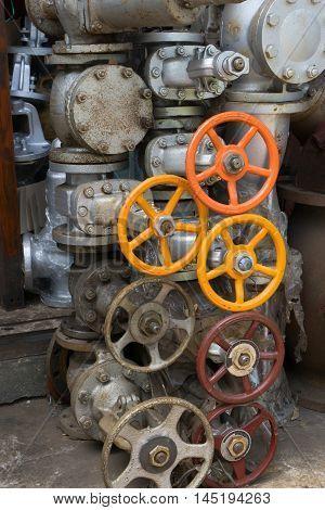 Orange and yellow Oil valve in valve Shop