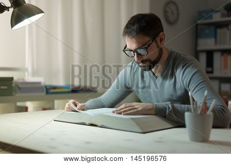 Smart Man Studying At Night