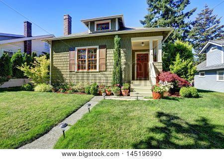 Small Green American Craftsman House Exterior.