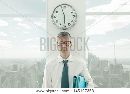 Frustrated Businessman Standing Under A Clock