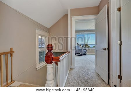 Empty Upstairs Hallway Interior With Light Pink Walls