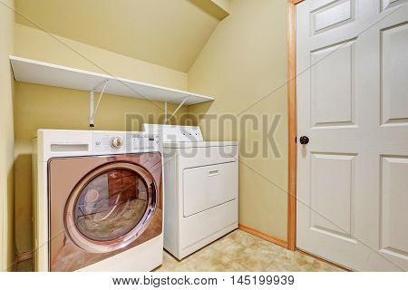 White Appliances In A Laundry Room With Vaulted Ceiling.