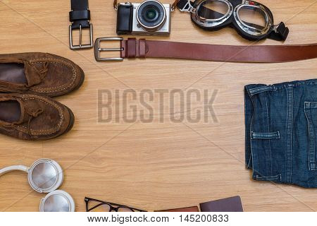 Flat Lay Top View Of Gentle Man's Casual Outfits On Wood Background
