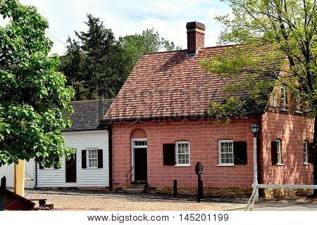 Old Salem North Carolina - April 21 2016: Colonial 18th century homes on Main Street